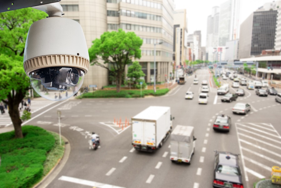 CCTV Surveillance camera operating on traffic road and people cross road in japan